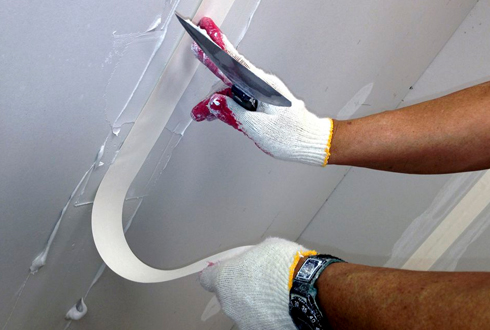 Taping - Residential interior painting services by Rios Interiors Corp